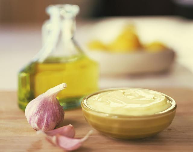 A recipe for an authentic Spanish aioli sauce, also known as allioli. It is a garlicky mayonnaise-like sauce that can be spiked with herbs such as a oregano.