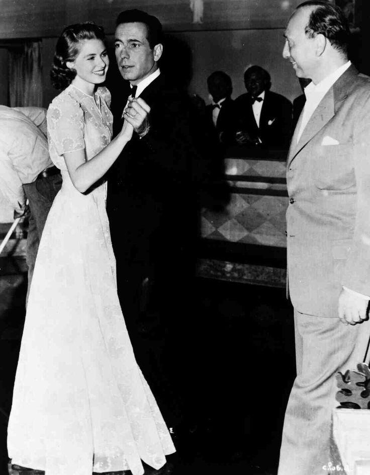 Casablanca   Full BTS shot of Ingrid Bergman as Ilsa Lund dancing with Humphrey Bogart as Rick Blaine while director Michael Curtiz looks on.