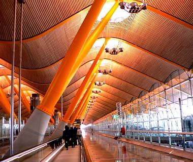 """Terminal 4, Barajas Airport in Madrid, Spain - Another one of the world's most beautiful airports (2010). Designed by Richard Rogers Partnership, Terminal 4 opened in 2006 and is """"easy to understand because it's linear, Rogers puts you inside a rainbow that stretches for half a mile"""" according to architecture critic Paul Goldberger"""