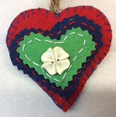 Red-blue-green felt heart w flower button. Made by Lilla.