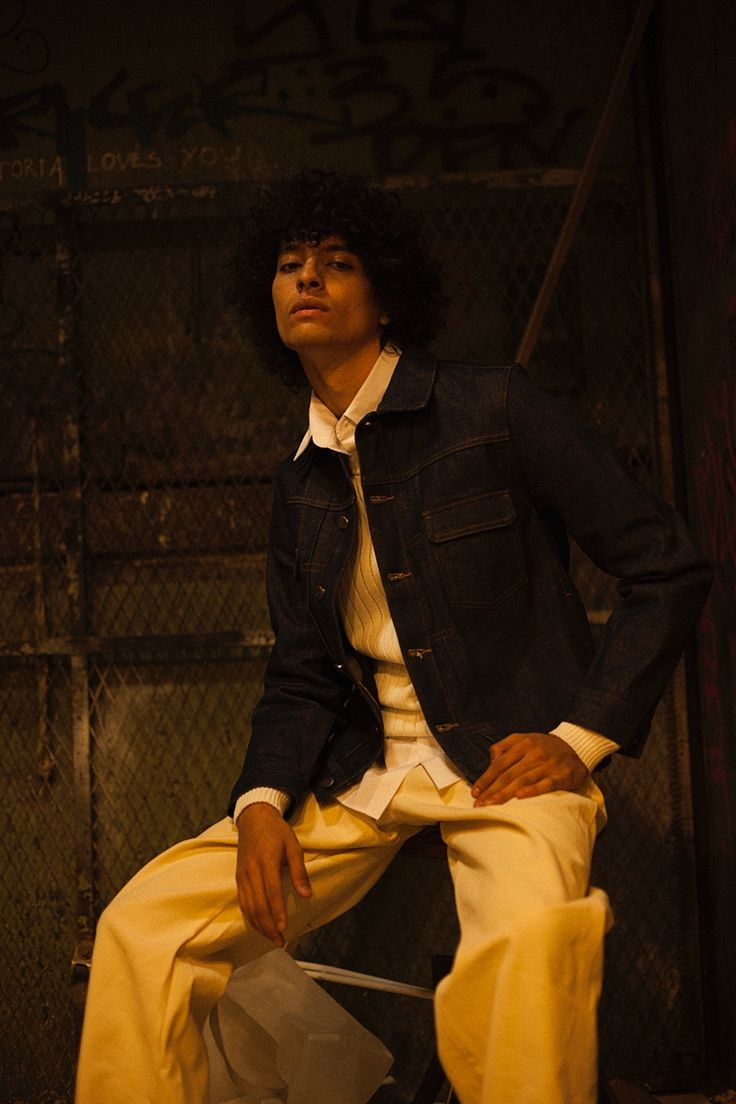 Liam wears denim jacket A.P.C., shirt Gosha Rubchinskiy, pants Carhartt, and shoes Converse.