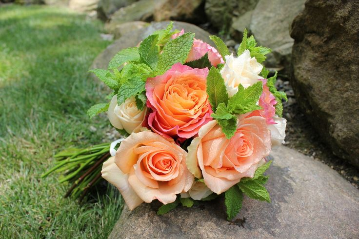 Dainty spring bridal bouquet featuring peach roses and mint.  So sweet!