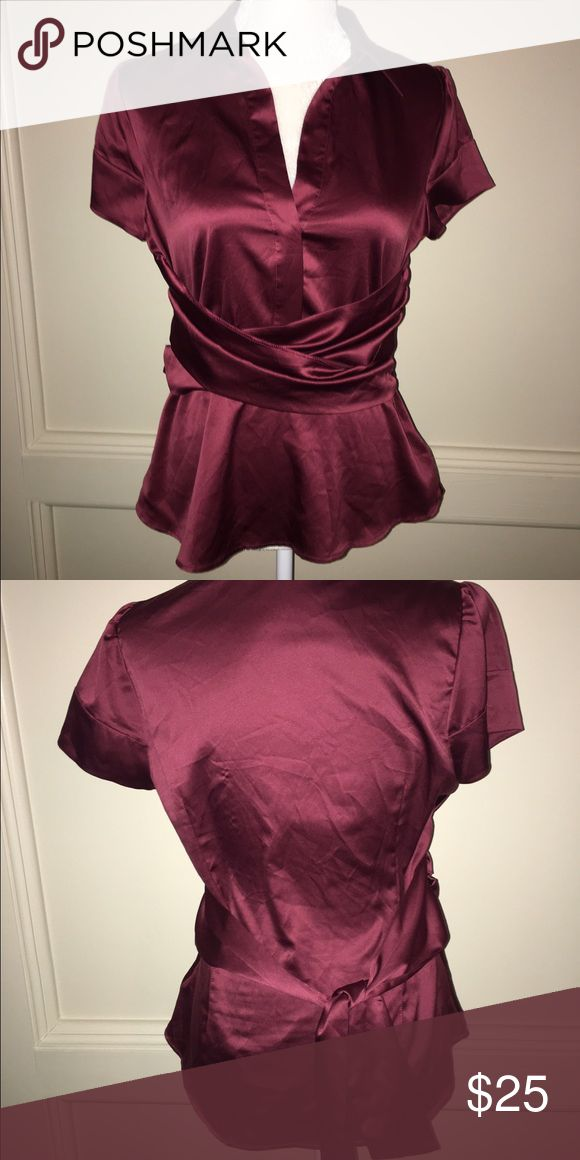 BCBGMAXAZRIA Top Beautiful burgundy top by BCBG. Side zip and tie at waist. Like new. Worn maybe one time. From top shoulder to bottom is abt 25. Across from underarm to underarm is abt 16 1/2 BCBGMaxAzria Tops Blouses