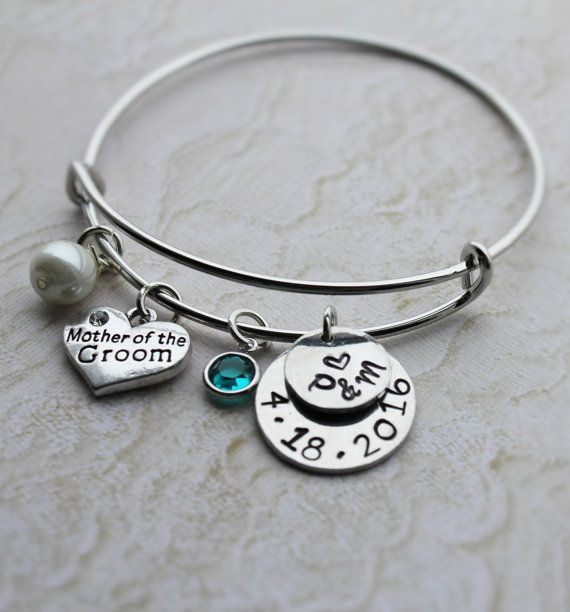 So cute! I like that it has the date and a charm for bride and groom initials.