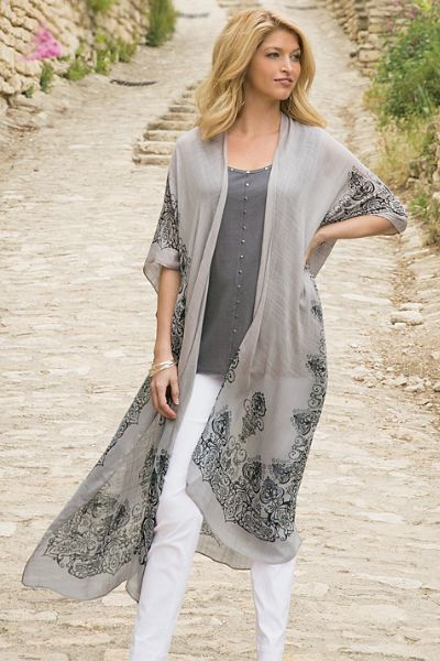 Long and flowy, our Colmar Cardi has a beautiful back medallion detail. A soft viscose makes this topper the perfect addition, even on the steamy nights of late summer. Just like a wearable piece of art, this top evokes hand-drawn pen-and-ink designs.