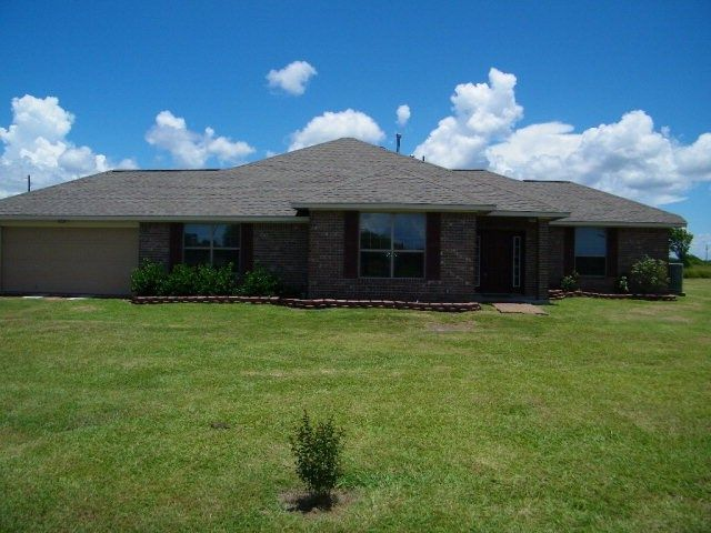 415 Serene Drive, Victoria, Texas 77905. Country Living at its finest! Great for gardening or horses. Custom built in 2012, 3 bed/2 bath split bedroom floor plan . Open concept with an oversized (18 x 24) living room. Raised ceilings and crown molding throughout the house. #homeforsale #customhome #custombuilthome #victoria #victoriatx #victoriatexas #victoriacounty #countryliving #russellcainrealestate