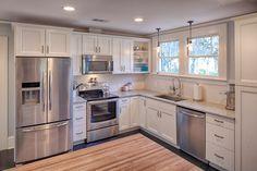 Traditional Kitchen with Subway Tile, L-shaped, Pendant light, Flush, Flat panel cabinets, Hardwood floors, Raised panel