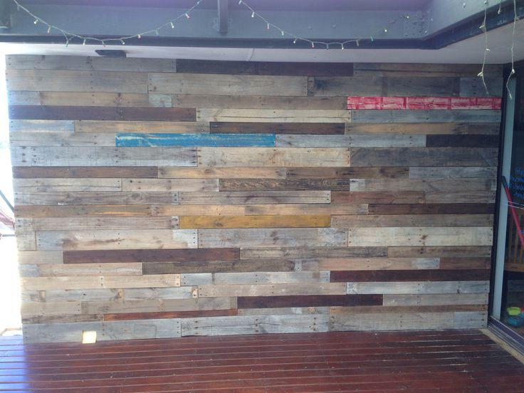 Pallet wall for outdoor patio area - nailed it!!