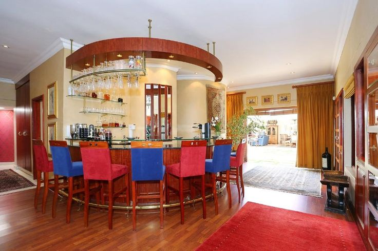 Situate in the tree lined suburb of Atholl, this Luis Ferreira da Silva designed cluster has it all. Feature Porte Cochere leads to double volume entrance with marble staircase, which leads to gallery overlooking the pool.  Formal dining room with fireplace & feature ceiling. Enormous inside-outside double entertainment area which has gas & coal braai facilities, leads to garden & pool. Feature bar & TV lounge are fully fitted & lead down to proper wine cellar.