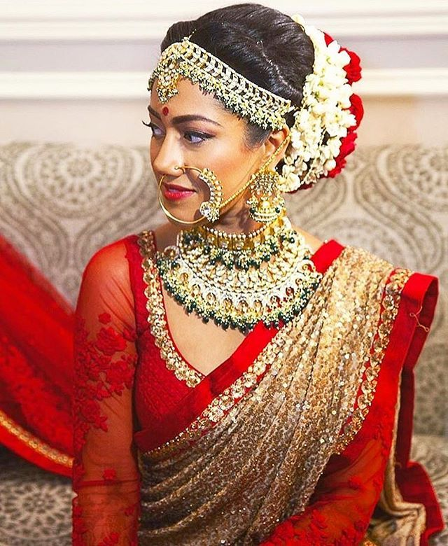 Gold saree with red border and red blouse are the perfect bridal ensemble #Sabyasachibrides #bridallehenga #wedfine