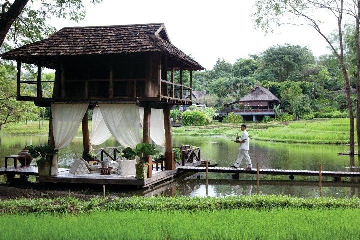 Stilted pavilions at @Four Seasons Resort Chiang Mai offer luxurious living space and a private Thai sala (terrace) with views of the resort's working rice paddy fields.