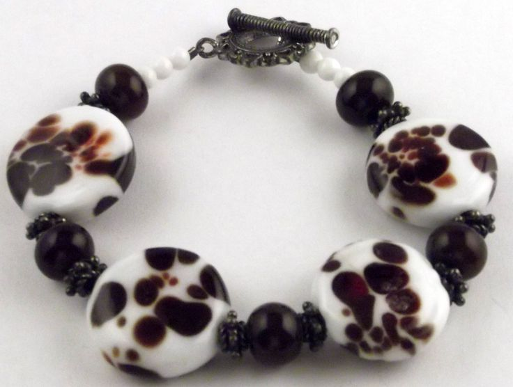 Lampwork glass bead bracelet.  White beads made with red frit.