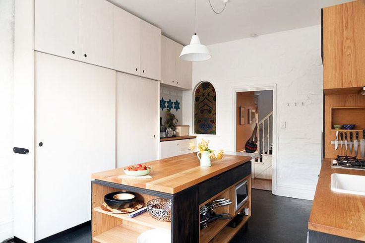 This kitchen refurb by Hearthused plywood as cabinet storage in an elemental Bauhausian way. We love geometry of the squares and rectangles, the the grain