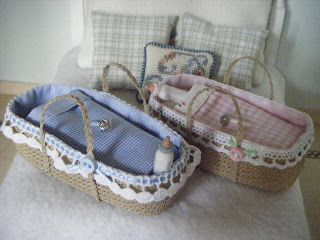 Baby basket from hardened canvas laid over a mold - finished with trim & bedding| Source: La Casa Rossa