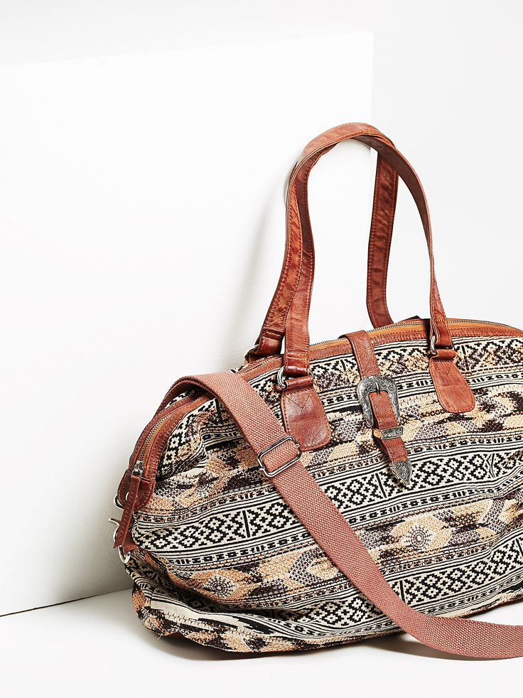 Monterey Weekender   Large, easy-to-carry bag perfect for your next weekend getaway. Featuring a cute tribal-inspired print and snap button closure decorated with an ultra cool western belt detail. Hold it how you want to with two short straps and a long shoulder strap that is both removable and adjustable. Top zipper closure. Lined inner with pockets.