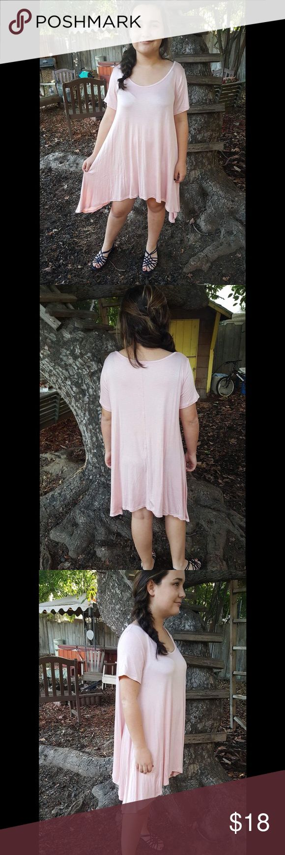 Light Pink Shark Bite Tunic Pretty pink tunic. Very comfortable  NWOT Length:30in Side Length: 33 in Bust: 40in All of my items are shipped same day if you buy before 2 PM PST. ALL OFFERS ARE CONSIDERED.. I would love to answer any questions you have about this tunic, just ask below. Tops Tunics