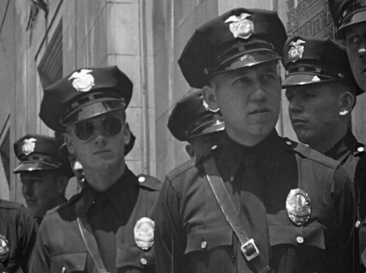 Your traffic officer, 1946 - Training film showing right and wrong way to direct downtown Los Angeles traffic, 1946. Intersections focused on are South Broadway at West 9th Street and South Grand Avenue at West 7th Street.