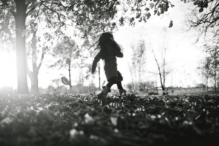 A girl running through autumn leaves in Ashton Park, Preston. Lifestyle Family Portraits