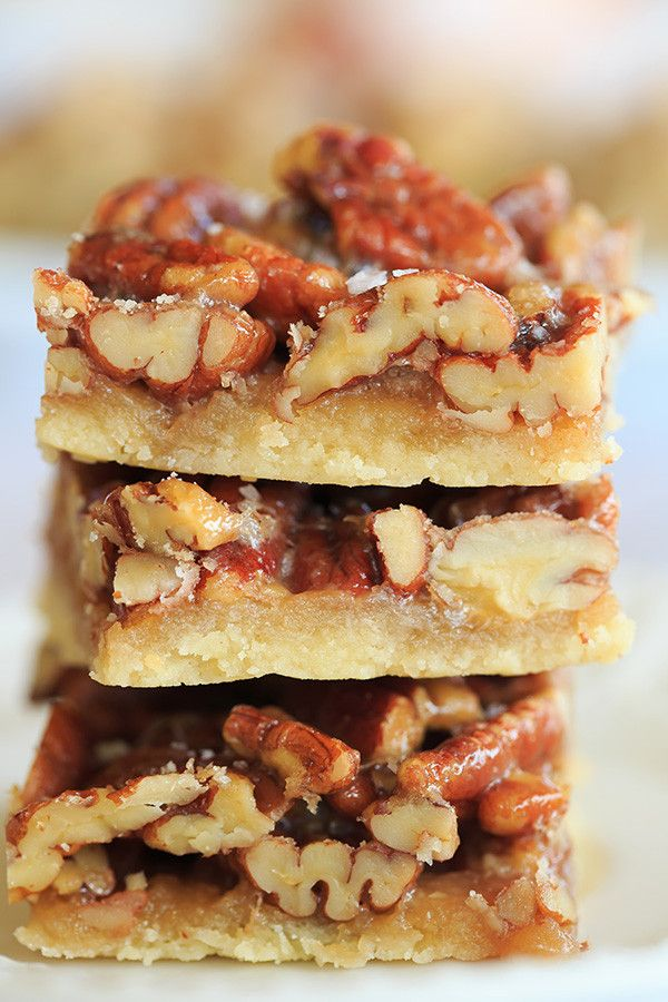 Ultranutty Pecan Bars - A shortbread crust acts as the base for these pecan bars that have a high nuts to filling ratio | browneyedbaker.com