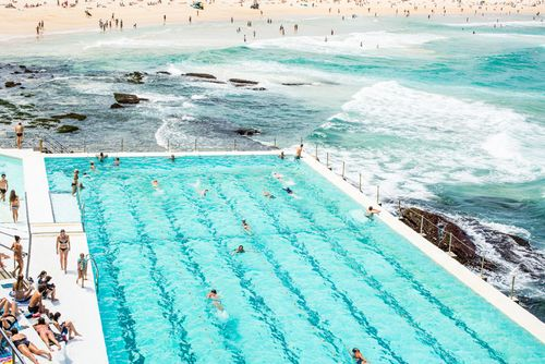 'Bondi Icebergs' Photographic Print by Kara Rosenlund. What I love about this image is how it provides a sensory overview of what brings people to this beautiful place. It encapsulates the many iconic scenes that Bondi has to offer sun seekers at play.  © Kara Rosenlund  Shop here: http://shop.kararosenlund.com/bondi-icebergs-photographic-print/