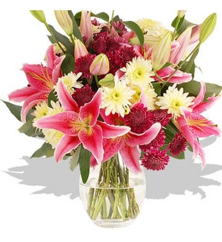 This arrangement contains the following flowers: 5x Purple Chrysanthemum 4 x White Chrysanthemum 5 x Pink Oriental Lilies Eucalyptus Robusta Hand-tied by our florists