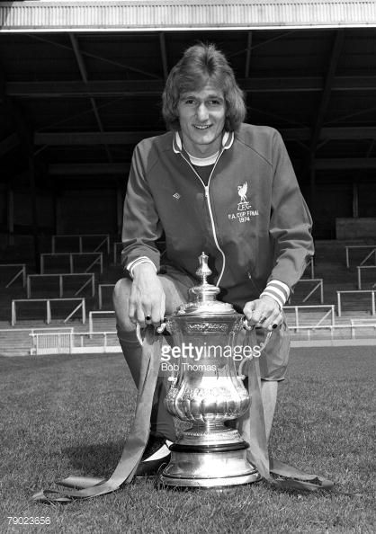 Sport Football England August 1974 Liverpool FC Photocall Liverpool FC's Phil Thompson is pictured with the FA Cup trophy that his side won against Newcastle United
