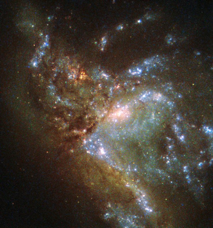 "This image, taken with the Wide Field Planetary Camera 2 on board the NASA/ESA Hubble Space Telescope, shows the galaxy NGC 6052, located around 230 million light-years away in the constellation of Hercules.  It would be reasonable to think of this as a single abnormal galaxy, and it was originally classified as such. However, it is in fact a ""new"" galaxy in the process of forming. Two separate galaxies have been gradually drawn together, attracted by gravity, and have collided."