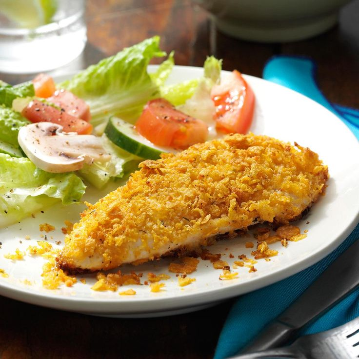 Breaded Ranch Chicken Recipe -A coating containing cornflakes, Parmesan cheese and ranch dressing mix adds delectable flavor to the chicken pieces in this recipe and bakes to a pretty golden color. It's a mainstay main dish I can always count on. -Launa Shoemaker, Landrum, South Carolina