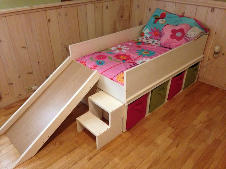 DIY toddler bed with slide and toy storage.