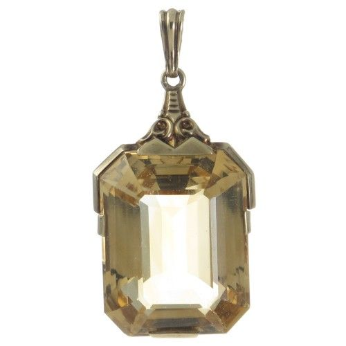 An 8ct yellow gold 1930s citrine pendant featuring an emerald cut citrine measuring approximately 2.5cm by 2cm. Pendant Length: 4cm approx including bale Stamped 333 a standard 1930s German gold mark for 8ct www.rutherford.com.au