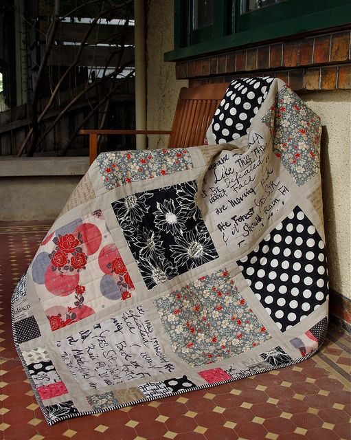 Fancy quilt, especially like the text fabric but the grid lines make it easier to use completely random fabrics.