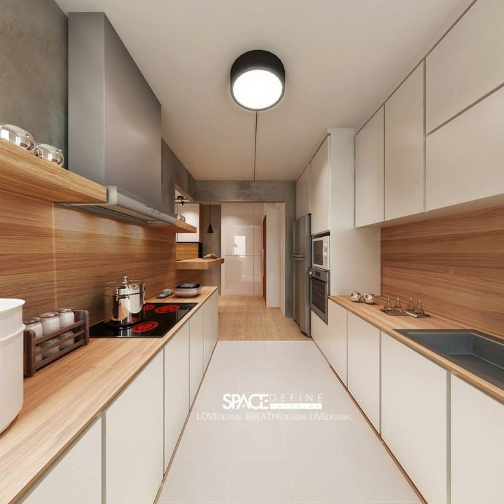 The worktop with the panelling in this kitchen really work to lengthen the room and draw the eye.