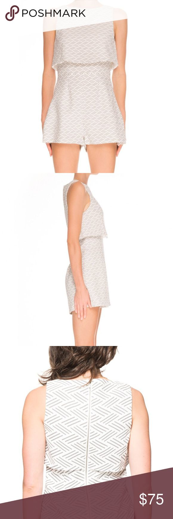 KEEPSAKE THE LABEL Motion Picture Playsuit/Romper The Motion Picture Playsuit is a fitted playsuit with a flared crop top overlay. It has an exposed back zip and is available in Keepsake's exclusive Basket Weave print. This tight, high-necked playsuit from Keepsake The Label features their exclusive large basket weave print in Ivory. It is fully lined with a loose crop top overlay and a silver zip up the back. Limited edition!  Main: 96% Polyester & 4% Elastane Lining: 100% Polyester…