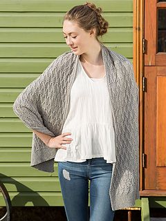 Eye-catching cables create a stunning texture in this long stole knit with five hanks of Berroco Fiora.