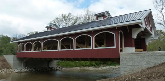 Preble County's newest covered bridge will be unveiled on Memorial Day.  Covered bridge enthusiasts will soon have another reason to visit Preble County as the completion of the Hueston Woods Double Barrel Covered Bridge is nearing.  The Hueston Woods Covered Bridge is located on Camden College Corner Road between Buck Paxton Road and Hedge Row Road.
