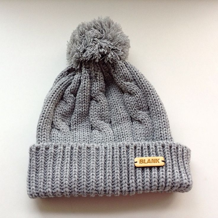 This grey knitted toque is one size fits all, with a hand-sown wooden label! All proceeds from sales are donated to charity!  Check out www.blankhatsforcharity.com for more!