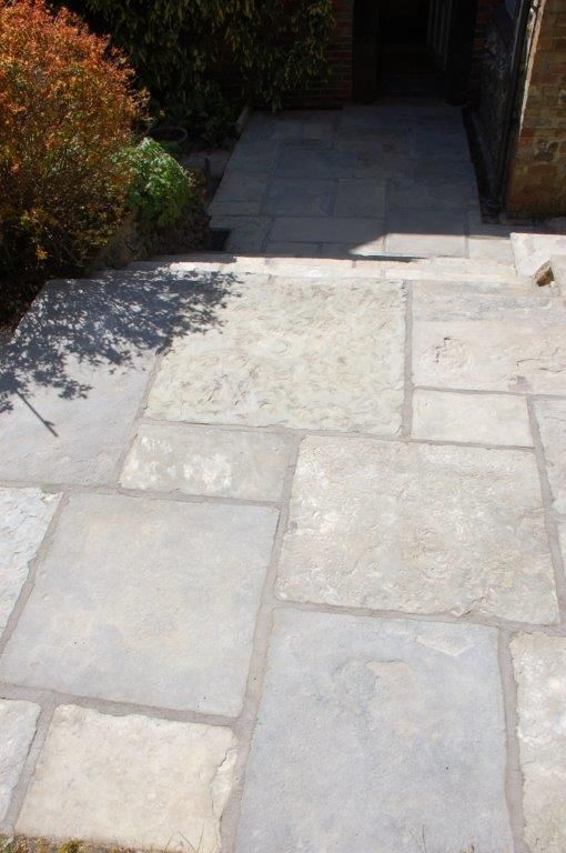 Reclaimed York stone was used for the paving and steps in this garden http://www.naturalstoneconsulting.co.uk/reclaimed-yorkstone-paving