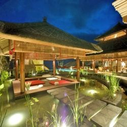 Tropical beachfront villa in Bali infused with a sophisticated Balinese modern style.
