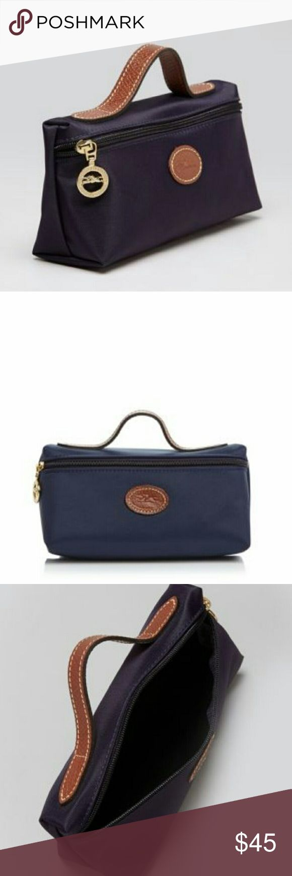 "Longchamp Cosmetic Case Lewis Pliage ?? Longchamp's nylon cosmetic case is the essential we can't live without! Ideally sized for extras: gloss, girlie things, gadgets, ect. 7.5""L x 2.5""W x 4""H navy with leather handle and logo. Zip closure. Longchamp Bags Cosmetic Bags & Cases"