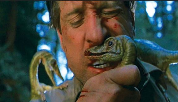 The featured hero Compy bites Dieter's lip - the effect made people on set cringe. Behind the scenes of THE LOST WORLD: JURASSIC PARK 2. Special Effects by Stan Winston Studio.