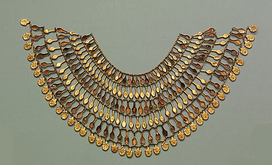 Egyptian Broad collar Necklace of Nefer Amulets Period: New Kingdom Dynasty: Dynasty 18 Date: ca. 1504–1450 B.C. Geography: Egypt, Upper Egypt; Thebes, Wadi Gabbanat el-Qurud, Tomb of the 3 Foreign Wives of Thutmose III, Wadi D, Tomb 1 Medium: Gold, crizzled glass, Egyptian blue