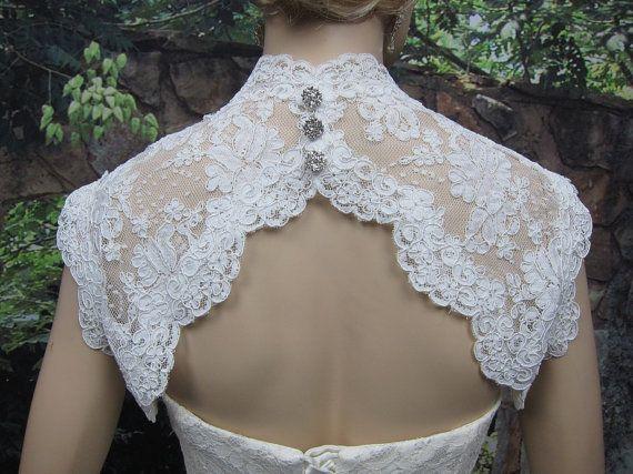 Ivory sleeveless bridal shrug lace bolero jacket wedding bolero - keyhole back - alencon lace. $79.99, via Etsy.