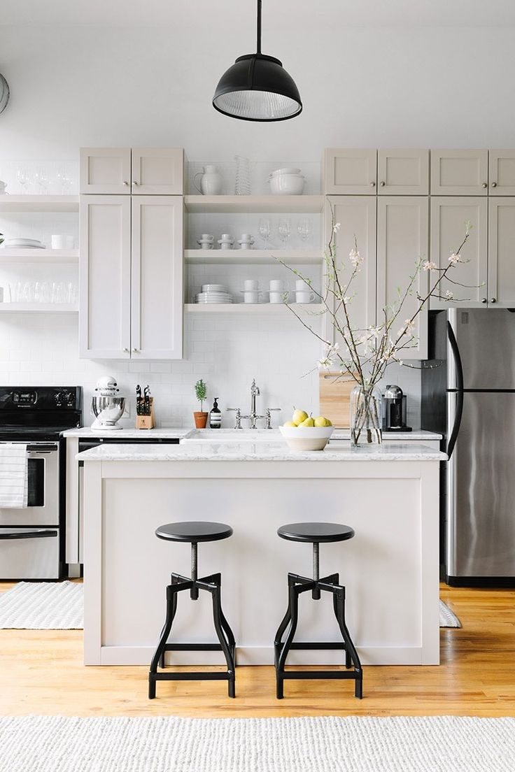 We've rounded up four elements of kitchen design that people tend to have especially strong opinions about, and debated the merits of each. From open shelving, upper cabinets, marble and open kitchen vs. closed kitchen — where do you fall?