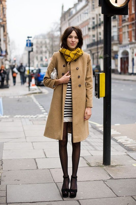 Rock a camel coat with a white and black horizontal striped tunic if you're going for a neat, stylish look. This combo pairs perfectly with black suede heeled sandals.  Shop this look for $124:  http://lookastic.com/women/looks/scarf-clutch-tunic-coat-tights-heeled-sandals/4263  — Mustard Scarf  — Silver Leather Clutch  — White and Black Horizontal Striped Tunic  — Camel Coat  — Black Polka Dot Tights  — Black Suede Heeled Sandals