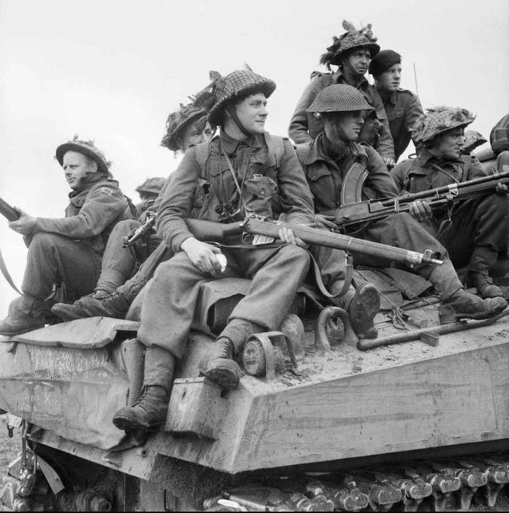 SEP 24 1944 The casualties mount inside Oosterbeek: Infantry ride on Sherman tanks in Holland, 24 September 1944.