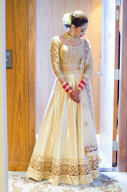 I really like the look of this lehenga! Indian bride wearing bridal lehenga and jewelry.