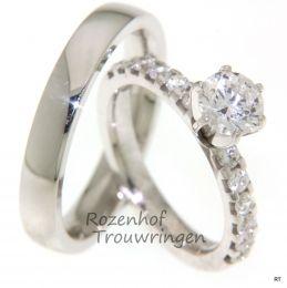 Deze witgouden trouwringen zijn van grote klasse. De breedte van de trouwringen is 3,4 mm. De dames trouwring is bezet met 12 briljant geslepen diamanten van 0,05 ct. en 1 diamant geslepen briljant van 1,0 ct.