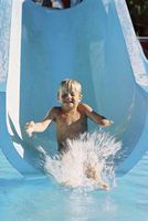 Use oversize surplus PVC pipe for a homemade water slide.