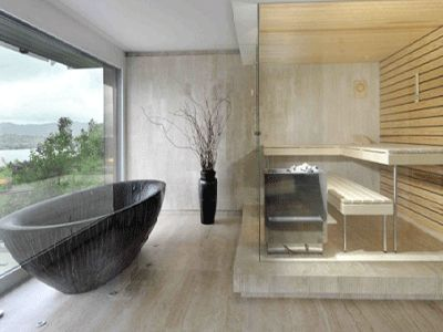 A contemporary bath with stone tub and a sauna. Say hello to the neighbors.