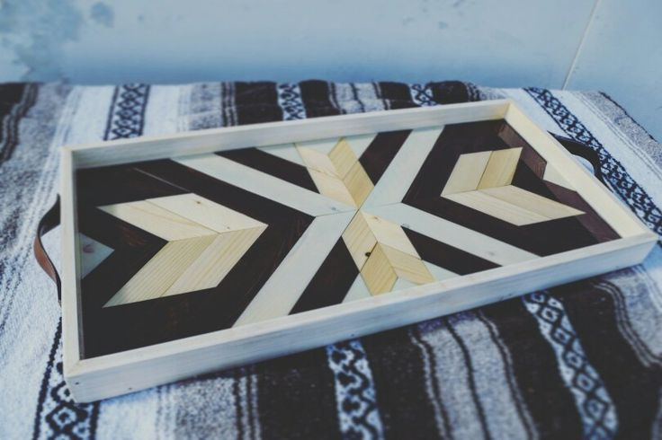 Gorgeous,  unique breakfast trays made by hand with repurposed leather handles.  Roaming Roots has those! Here's where: https://www.etsy.com/listing/234517897/symmetrical-wood-breakfasttray-with